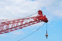 A rock crane on sky. Closeup a rock crane is against on blue sky Stock Photo