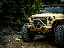 Orange Jeep Rock Crawling royalty free stock image