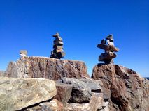 Rock creations. Rocks stacked to form balanced building designs Stock Photos