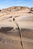 Rock crevice. Crevice in the granite stone Stock Photos