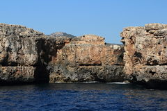 Rock, Cruise Ship from Es Forti, Cala d´Or, Cala Gran, Cala Esmeralda, Cala Ferrera to Porto Colom, Majorca. Residences, Cruise Ship from Es Forti, Cala d´Or Royalty Free Stock Images