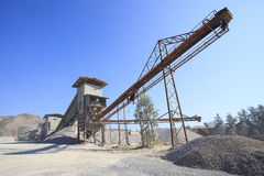 Rock crusher machine industry chain moving to logistic gravel us Stock Photo