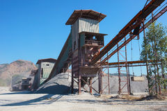 Rock crusher machine industry chain moving to logistic gravel us Royalty Free Stock Image