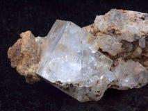 Rock crystal. Sample Rock crystal on a black background Stock Image