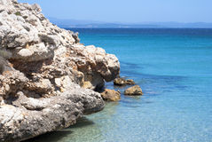 Rock on the crystal-clear and transparent water of the sea. Of Sardinia Royalty Free Stock Photo