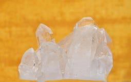 Rock crystal on yellow Stock Image