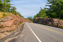 Rock cut on a highway Stock Photo