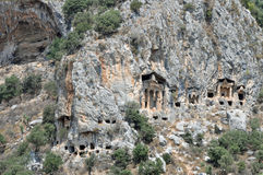 Rock cut and niche tombs at ancient Kaunos in Turkey Royalty Free Stock Image