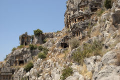 Rock-cut tombs in Myra, Demre, Turkey, Scene 2. A series of photos. Rock-cut tombs in Myra, Lycian tombs, near the city of Demre in modern Turkey Royalty Free Stock Photo