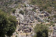 Rock-cut tombs in Myra, Demre, Turkey, Scene 2. A series of photos. Rock-cut tombs in Myra, Lycian tombs, near the city of Demre in modern Turkey royalty free stock photos