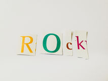 Rock - Cutout Words Collage Of Mixed Magazine Letters with White Background. Caption composed with letters torn from magazines with White Background Royalty Free Stock Photography