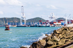 Rock dam protection sea and blurred background of trade port Royalty Free Stock Photography