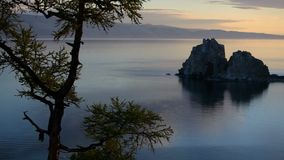 Rock at dawn in the summer. Shaman rock, the sights of lake Baikal, at dawn in the summer stock video