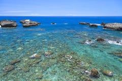 Rock  the deep blue ocean. Stock Photography