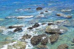 Rock  the deep blue ocean. Royalty Free Stock Image