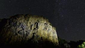 Rock del granito del Lit con las estrellas Imágenes de archivo libres de regalías