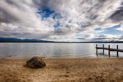 Rock, dock, blue sky clouds Royalty Free Stock Images