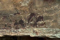 Rock drawing of long past San people (Bushman) in Giants Castle Cave Royalty Free Stock Images