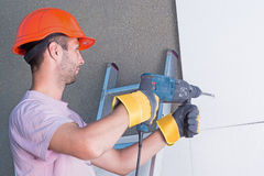 Rock-dril. Worker with rock-drill warms the wall Stock Images