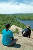 Rock Dunder Hiking Trail, Lyndhurst, Ontario, Canada. Hikers on the summit of the Rock Dunder Hiking Trail, above the Rideau Canal, Lyndhurst, Ontario, Canada, a stock photo