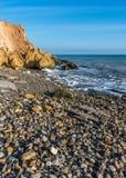 Rock on the edge of the Black Sea. Warm late autumn day on the seashore near the village of Fontanka, Odessa region, Ukraine royalty free stock image