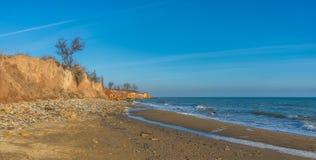 Rock on the edge of the Black Sea. Warm late autumn day on the seashore near the village of Fontanka, Odessa region, Ukraine royalty free stock photography