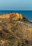 Rock on the edge of the Black Sea. Warm late autumn day on the seashore near the village of Fontanka, Odessa region, Ukraine stock image