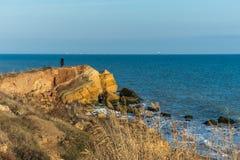 Rock on the edge of the Black Sea. Warm late autumn day on the seashore near the village of Fontanka, Odessa region, Ukraine royalty free stock photo