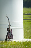 Rock eletric guitar standing in its carrier Stock Images