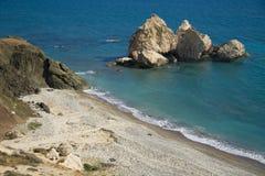Rock and empty beach Stock Photos