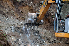 Rock Excavation. Excavator digging a trench for a pipe line Stock Photos