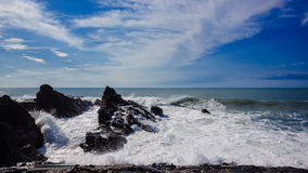 Rock Exposures Jutting from Ocean. Waves crashing on the rocks in Bude, England Stock Images