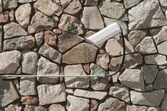 Rock facade with security surveillance camera Royalty Free Stock Photos