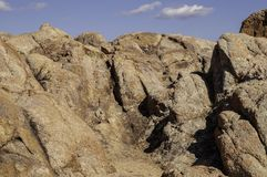 A rock face in the Arizona desert. With white clouds and blue skies stock photo