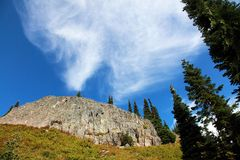 Rock Face with Clouds Stock Image
