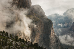 Rock face in foggy weather Stock Image