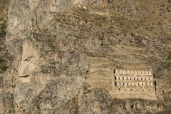 Rock face of Inca God, carved in the mountain. Rock face of Inca God in Ollantaytambo ruins Royalty Free Stock Photos