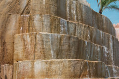 Rock Face Made of Steps with Water Falls. Water Cascading Down a Rock Face, Water Falls Royalty Free Stock Photography