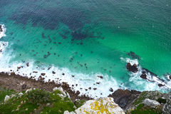 Rock face into the sea. A view from above the sea in South Africa Stock Photography
