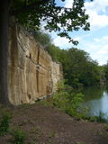 The rock face and small lake on Košutka in Pilsen Royalty Free Stock Photos