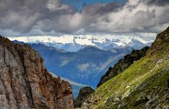 Cliffs of Carnic Alps with ridges and glaciers of Hohe Tauern Royalty Free Stock Image