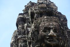 Rock faces in the temple of Bayon, Angkor, Cambodia royalty free stock image