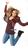 Rock fan. Jumping happy female rock fan stock photo