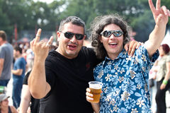 Rock fans at Tuborg Green Fest. People at rock festival saluting and drinking beer. Photo taken at Tuborg Green Fest 2012 in Bucharest Royalty Free Stock Image