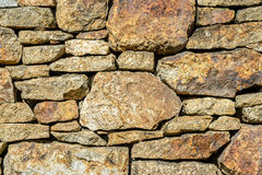 Rock fence in garden Royalty Free Stock Image