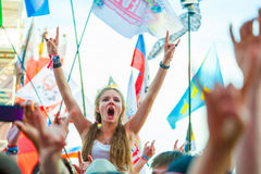 Rock festival. BIG ZAVIDOVO, RUSSIA - JULY 5: People cheering at open-air rock festival Nashestvie on July 5, 2014 in Big Zavidovo, Russia. Nashestvie is the Royalty Free Stock Image