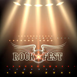 Rock Festival Poster Template. Stage in spotlights and wording Rock Fest decorated by wings and star. Free font used Stock Photos