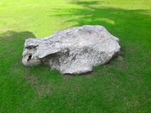 Rock on field. Big rocks on green grass and have a shadow Royalty Free Stock Photo