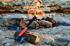 On the rock a fire burns in a homemade barbecue lined with stones royalty free stock photos