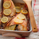 Rock Fish Baked with Lemon Stock Photography
